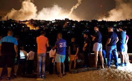 Spectators watching Gaza